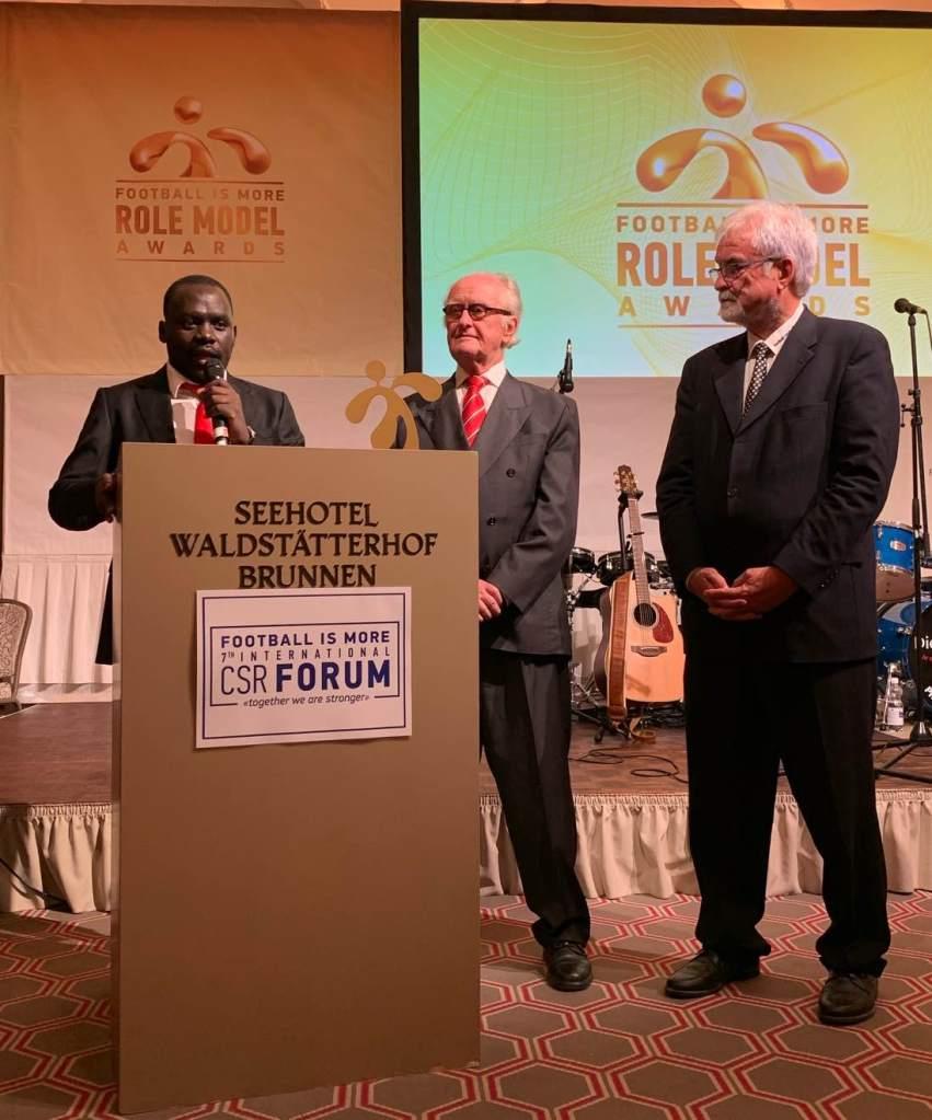 Hamilton Ayiera Nyanga, Heribert Scharrenbroich und Alois Kessler, Präsident von FiM (v.l.n.r.)